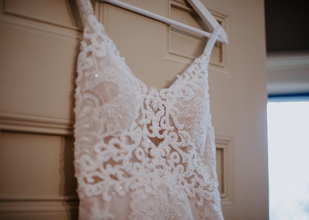 detail shot hanging gown spokane bride winter wedding
