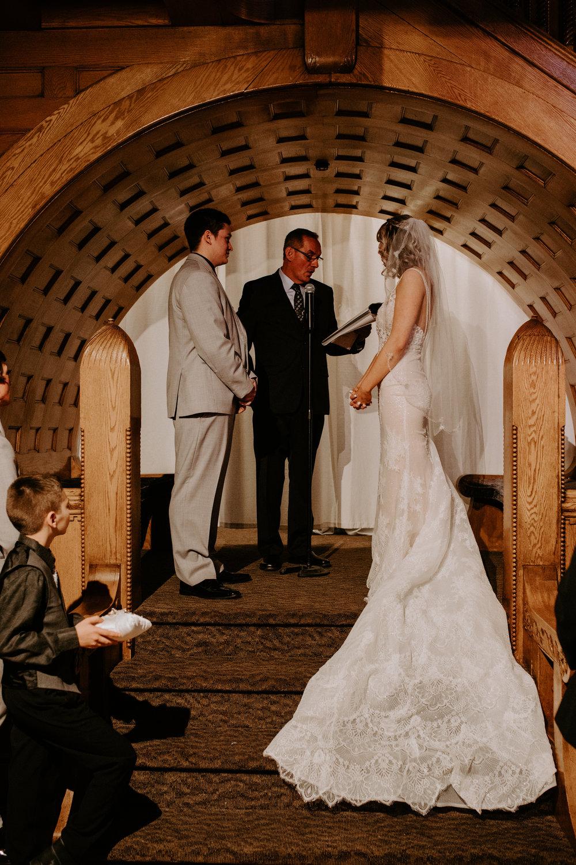 ceremony bride and groom at altar spokane wedding