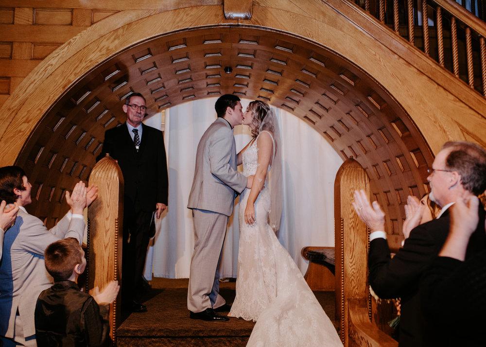 first kiss husband and wife bride and groom spokane wedding