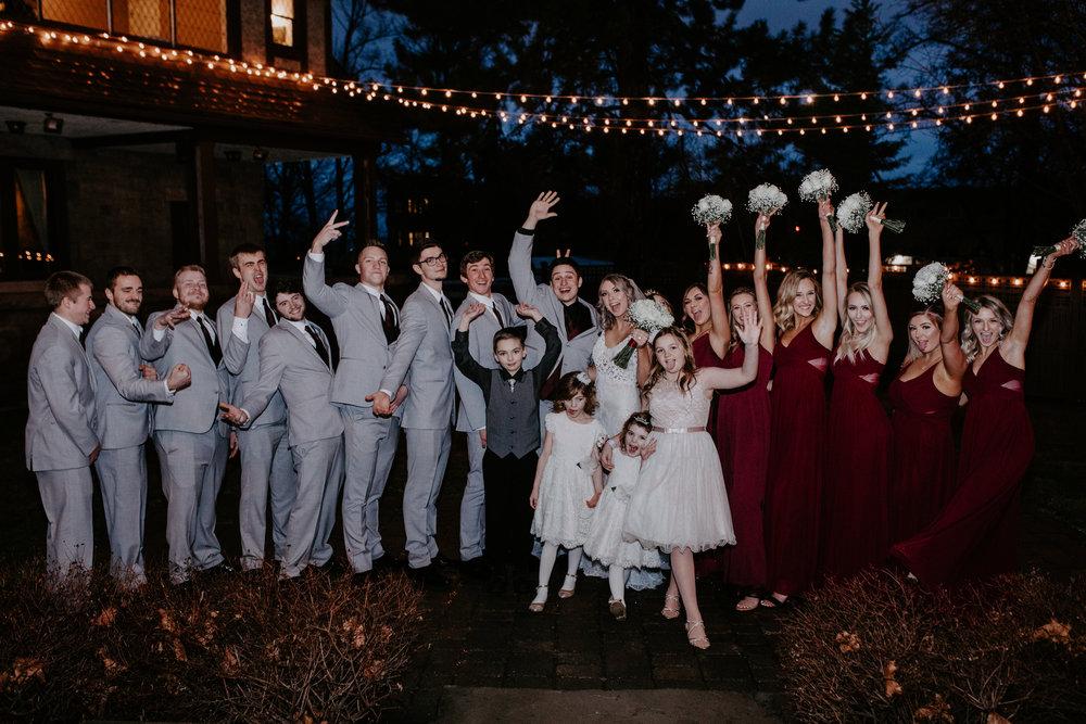 happy bridesmaids groomsmen bride groom spokane bridal shop