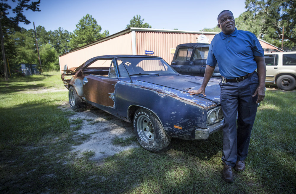 Mr. Bryant with his limited edition 1969 Dodge Charger 500 before we start working. It's going to be a rebuild for his daughter. He's only its second owner.