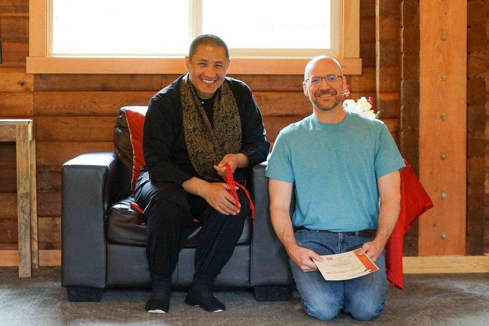 John receiving his teacher certification from Tulku Lobsang Rinpoche