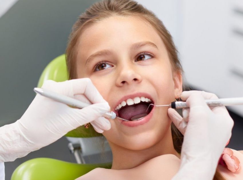 girl at dentist smile style check-up.jpg
