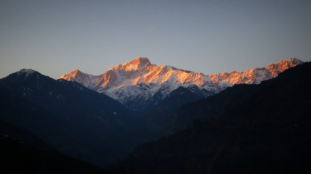 March, 2015. Kedarnath Mountain shines in the light of the setting sun. The mountain is considered to be a living form of Lord Shiva Himself. This land here, with its famed five temples dedicated to Shiva (the Panch Kedar shrines, of which the Kedarnath Mandir, at 12,000 feet, is one) is where the hidden Lord Shiva emerges and reveals Himself to His devotees.