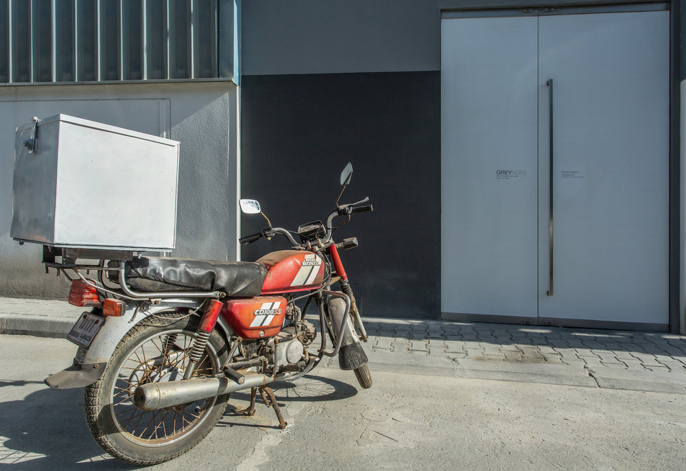 Home-delivery motorcycle parked outside 2014 Variable dimensions