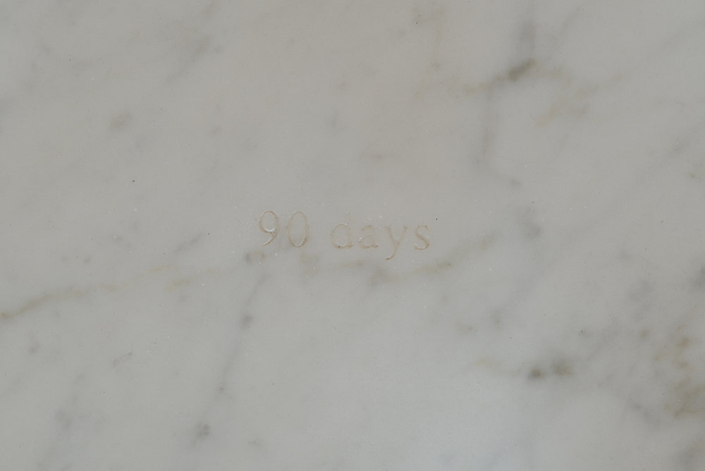 90 days, 90 nights (detail) 2016 Carrara marble, Lebanese newspaper Al Nahar, black sheets Dimensions variable
