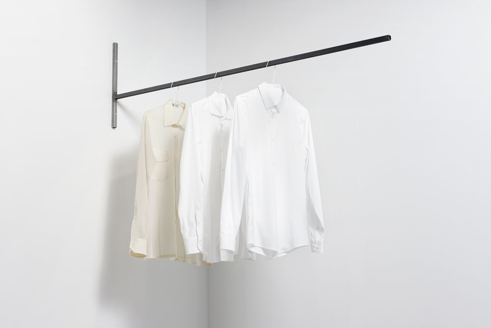 Three abstractions on three histories 2016 Three white shirts, metallic structure, time Dimensions variable   In 'Three abstractions on three histories' 3 shirts, apparently similar, hang high from the ground. They seem to belong to the same person, but in reality one belonged to the artist's grandfather, the second to his father and the third to the artist. Each refers to a time, and contains a part of the Lebanese history.