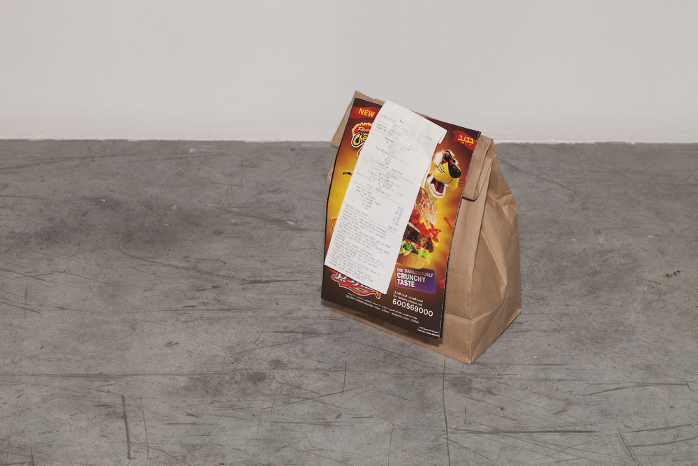 Lantian Xie  Roast Beef, Hotdog, Superstar 2016 Sculpture: brown-paper delivery bag from Hardees fast food restaurant, with delivery menu and receipt affixed to one side