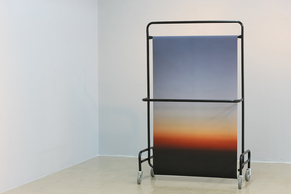 Stéphanie Saadé  Suspended Horizon 2012 Metallic structure, photograph (300 x 90 cm) 170 x 100 x 50 cm Wherever he goes, the viewer moves around the romantic horizon.