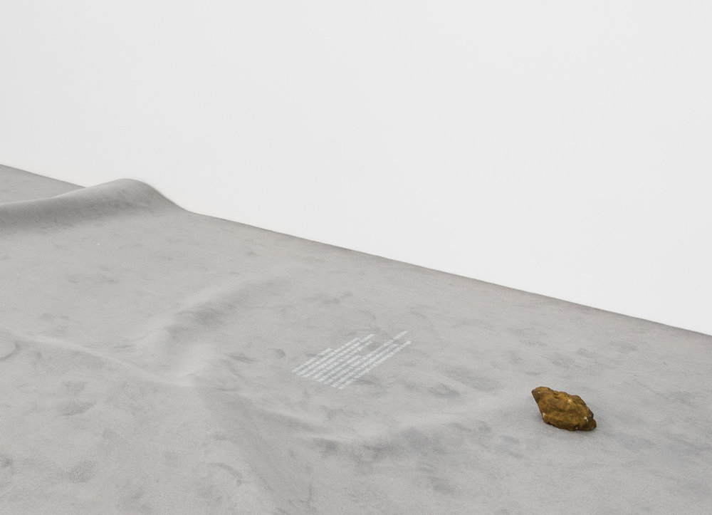 Charbel-joseph H. Boutros  A removed stone 2013 - 2018 Stone, carpet, projected text, forest, faith