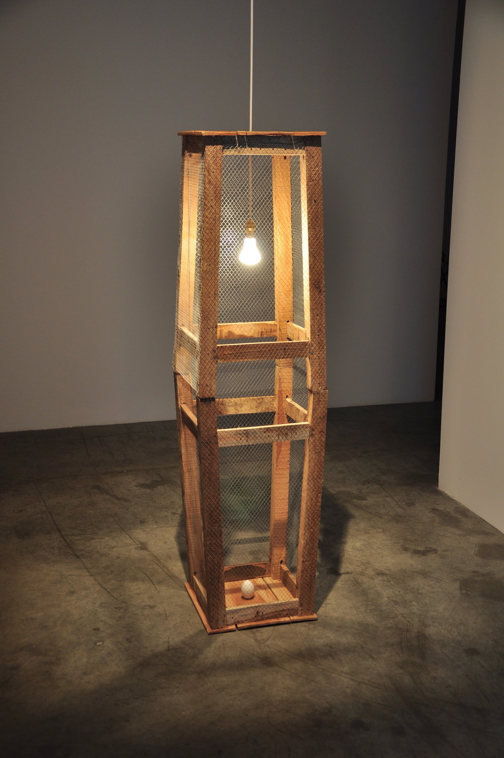 Ehsan ul Haq  Creation of Adam 2011 Wooden stools, chicken mesh, light bulb & an egg 152.4 x 45.7 x 45.7 cm Edition of 3+1AP