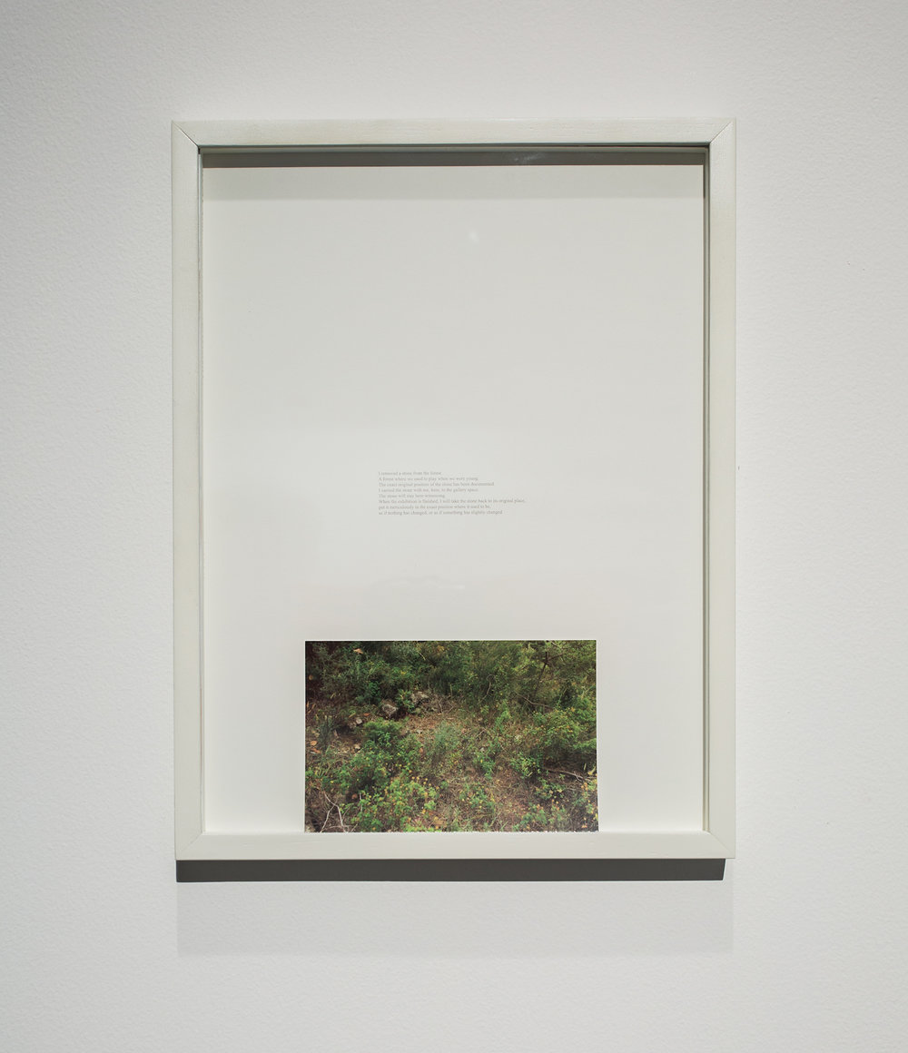 Charbel-joseph H. Boutros  A removed stone 2013 Plaster replica of stone removed from Naas forest in Lebanon, inkjet on newspaper, wooden shelf, c-print