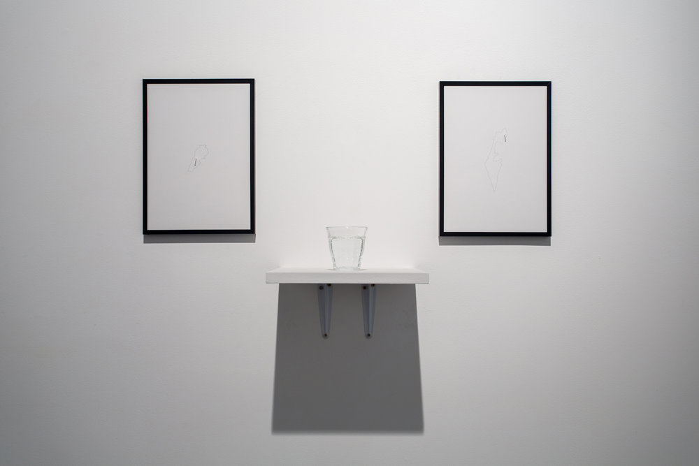 Charbel-joseph H. Boutros  Mixed Water, Lebanon, Israel 2013 Glass of water, an equal mix of Lebanese mineral water (Sohat) and Israeli mineral water (Eden), wooden shelf, inkjet print on recycled paper, painted nails Dimensions variable Edition 1/3