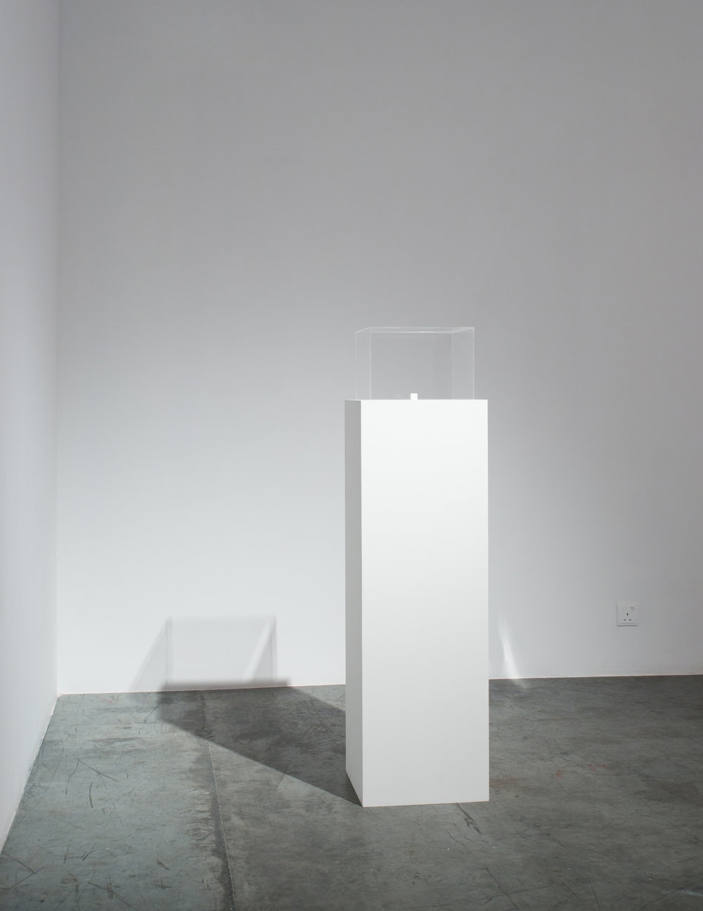 Charbel-joseph H. Boutros  1 cm3 of infinite darkness 2013 Steel polished mirrors, darkness, wood, white paint 1.8 x 1.8 x 1.8 cm Edition 1/3