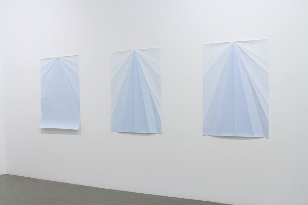 Caline Aoun  Blue Paperplane 2010 Series of Unique inkjet prints on folded paper 146 x 105 cm (each)