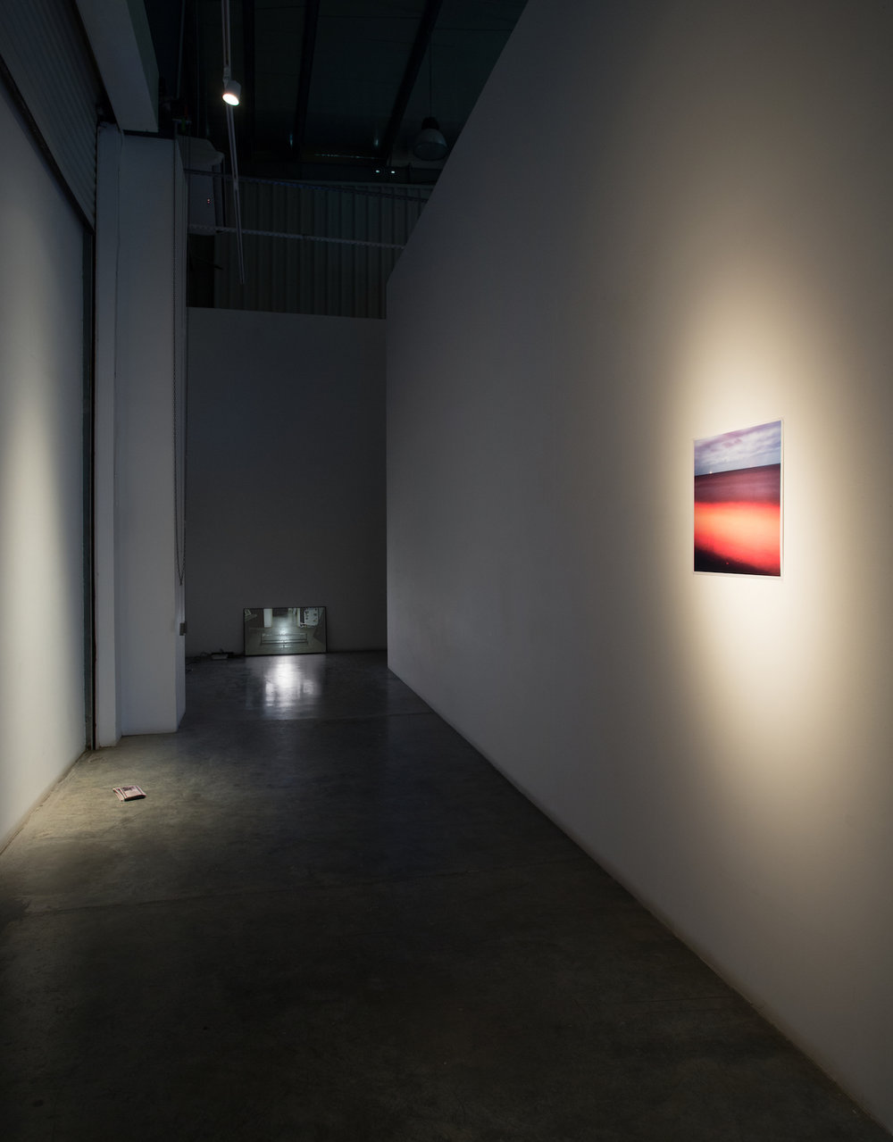Installation view, L - R   LEFT: Lantian Xie, Dubayygeists - Hong Kong Restaurant takeaway menus (commissioned for the exhibition) 2015   CENTER: Michael John Whelan Now the shadows I measure 2015 HD video, silent 00:01:46 loop Ed of 3 + 2 AP  RIGHT: Michael John Whelan That we were to wait 2015 c-print 45.5 x 45.5 cm Ed of 5 + 2 AP