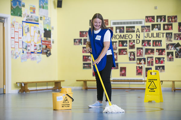 Astrum team cleaning Midlands school floor