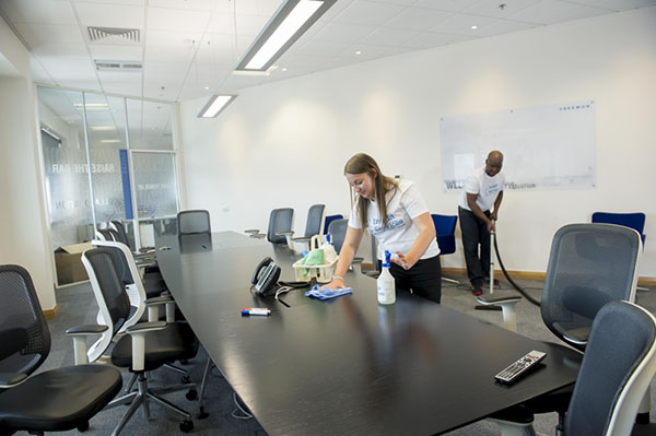 Nottingham Office Cleaning Team sanitising and vacuuming office