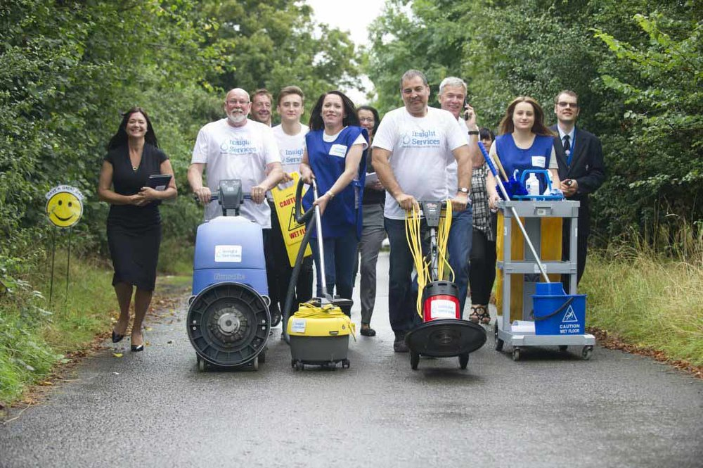Nottingham Contract Cleaning team in line up with machinery