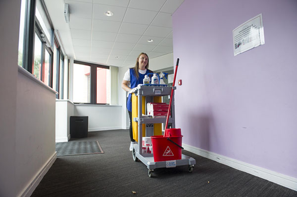 office personnel with cleaning cart