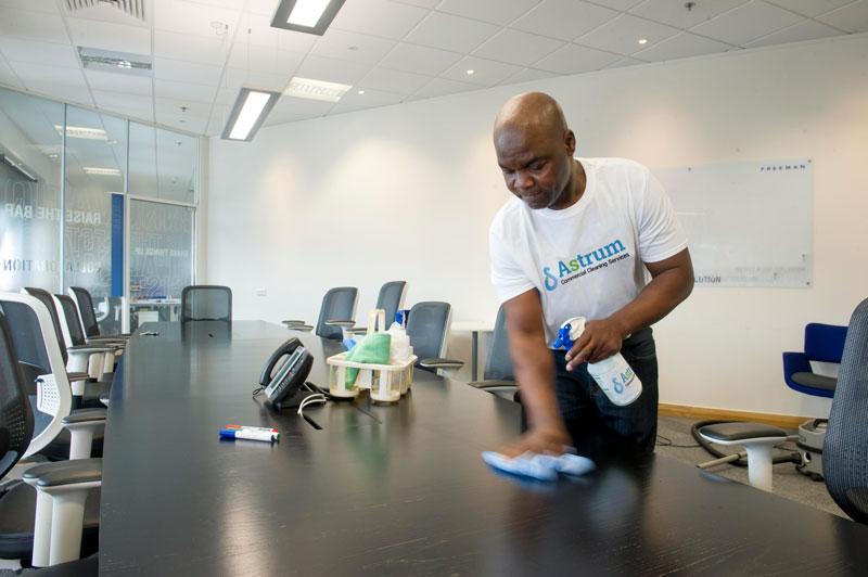 Derby Office Cleaning team cleaning and polishing office furniture