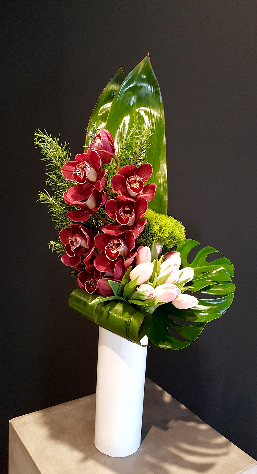 Red and white flowers with bold leaves for a decorative touch to corporate spaces