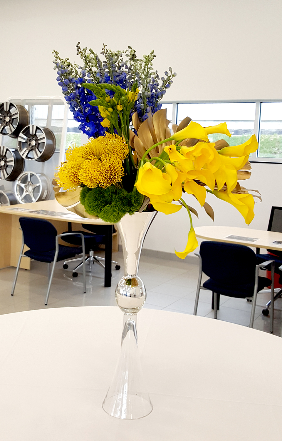 Yellow and purple flower arrangements in an office break room