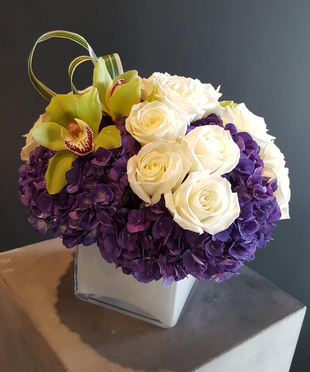 purpleHydrangeaswhiteRosesgreenCymbidiumOrchidsSignatureCollection-ID-953bd6cf-d397-4b78-a367-7d73b04f1226.jpg