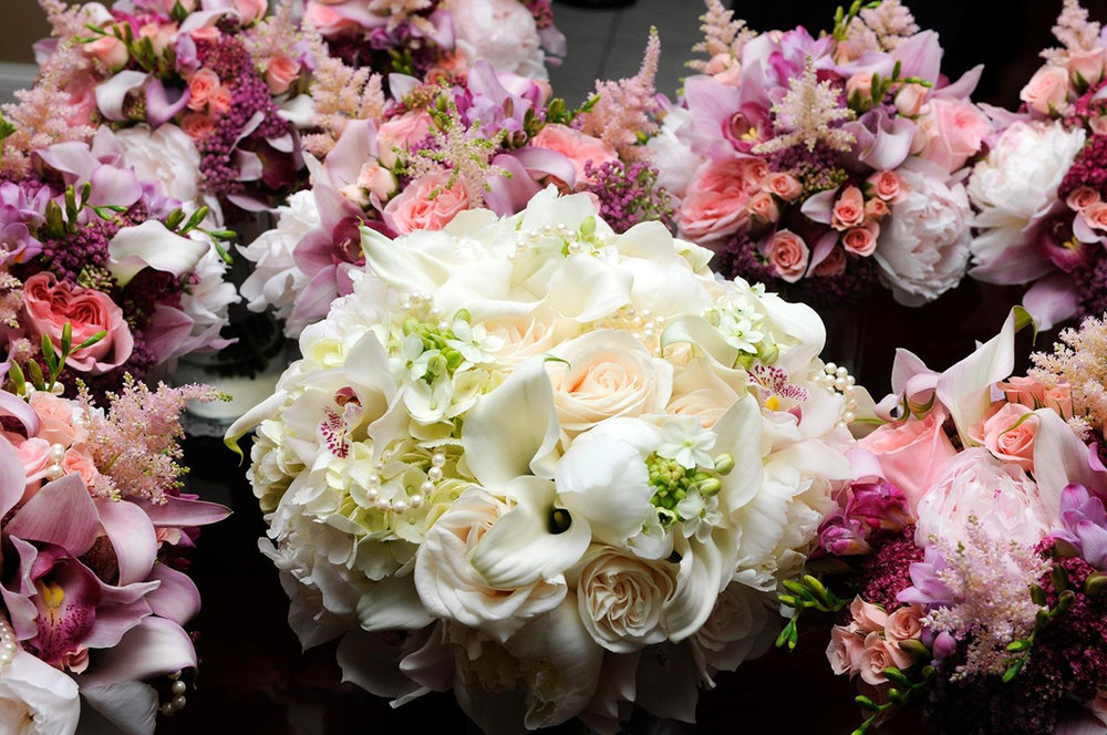 Opulent bouquet of pink and white flowers arranged by Bouquets & Beyond