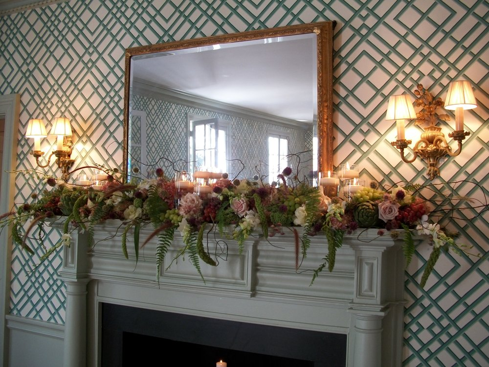 Floral arrangement on a fireplace mantle