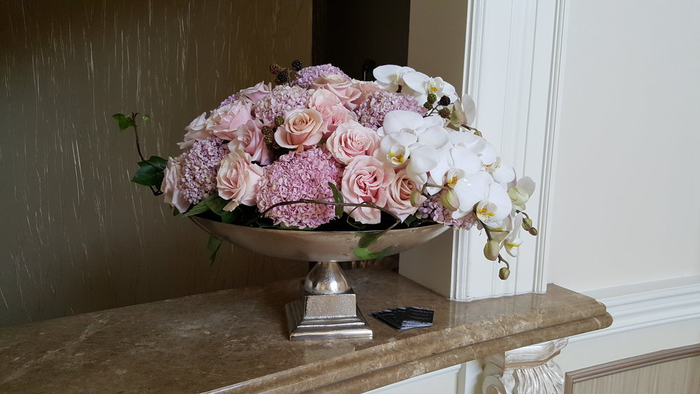 Simple yet elegant floral arrangement of orchids, lilacs and pink roses