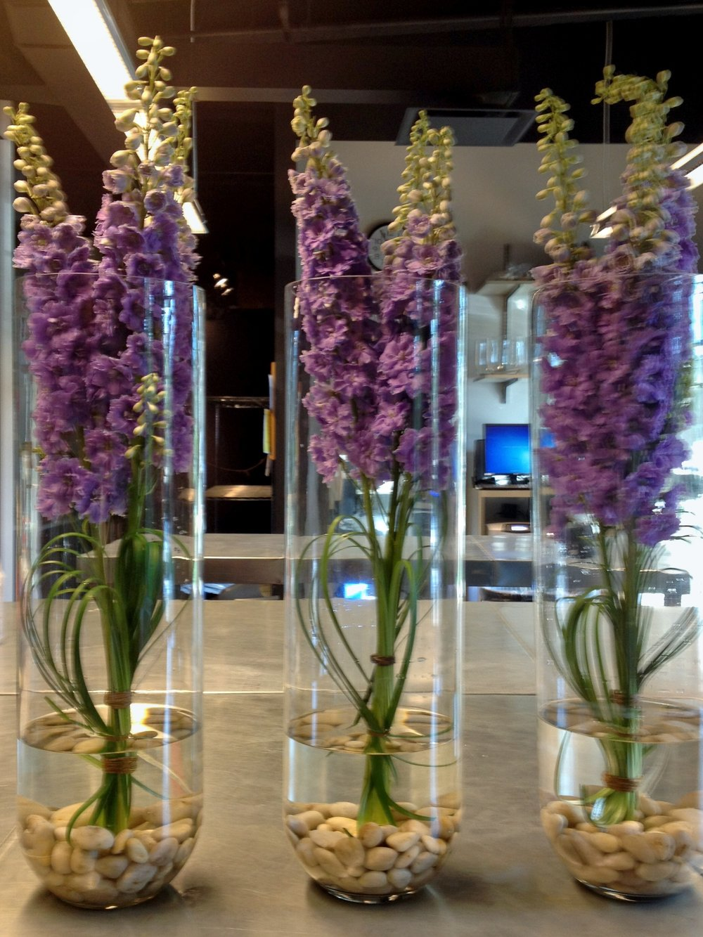 Floral arrangements for restaurant tables designed by Bouquets & Beyond