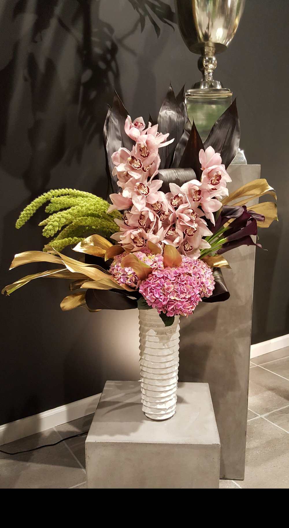 Pink floral arrangement for office spaces and restaurant decor