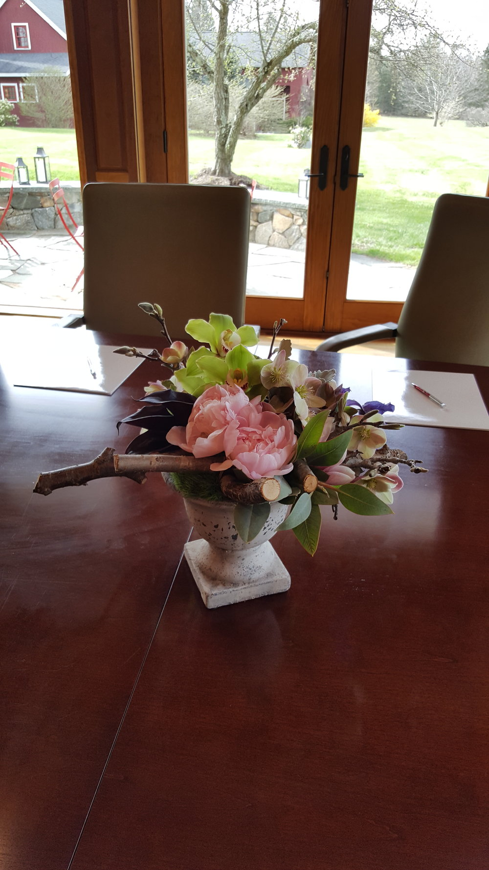 Conference table flower centerpiece designed by Bouquets & Beyond