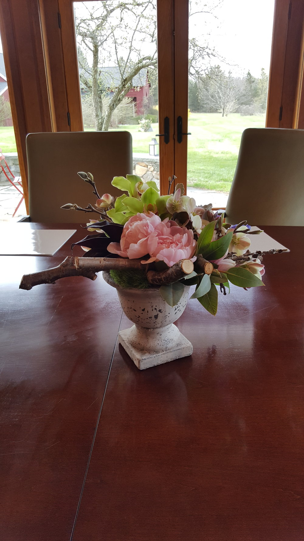 Conference table flower arrangements made by Bouquets & Beyond