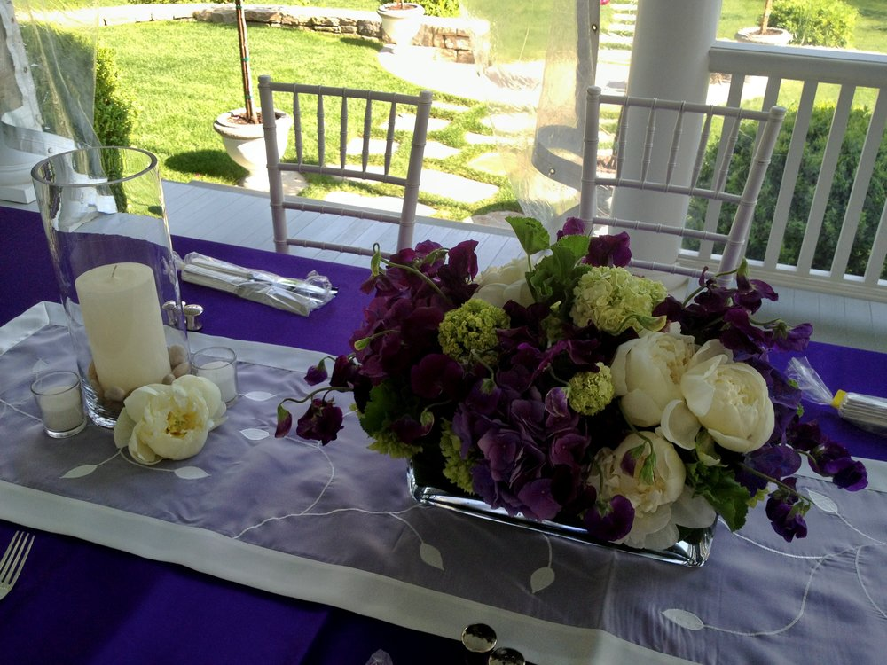 Table centerpiece for a celebration from Bouquets & Beyond