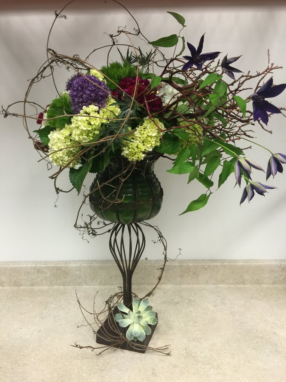 Earthy floral arrangement in vase for the home