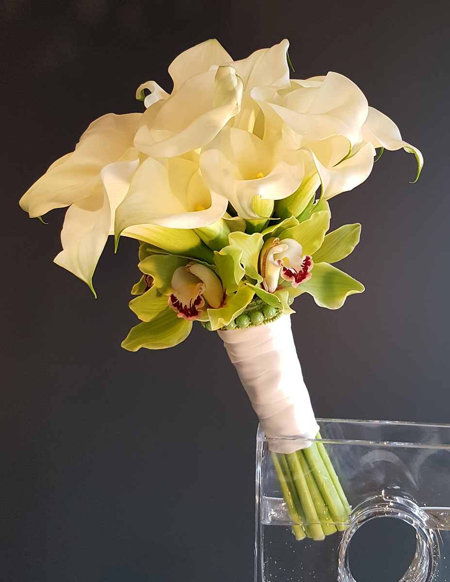 Bouquet of white flowers in crystal vase for wedding