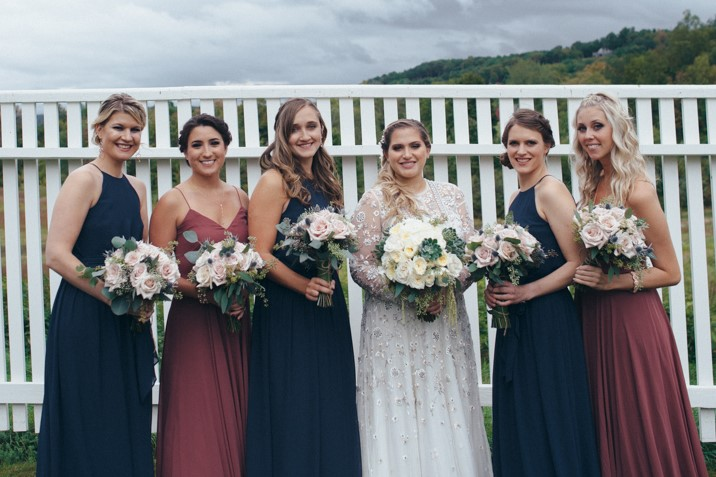 Bride with wedding party holding intricately designed flowers from Bouquets & Beyond