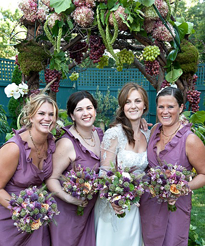 Bride and Bridesmaids with their bouquets from Woodbury florist shop