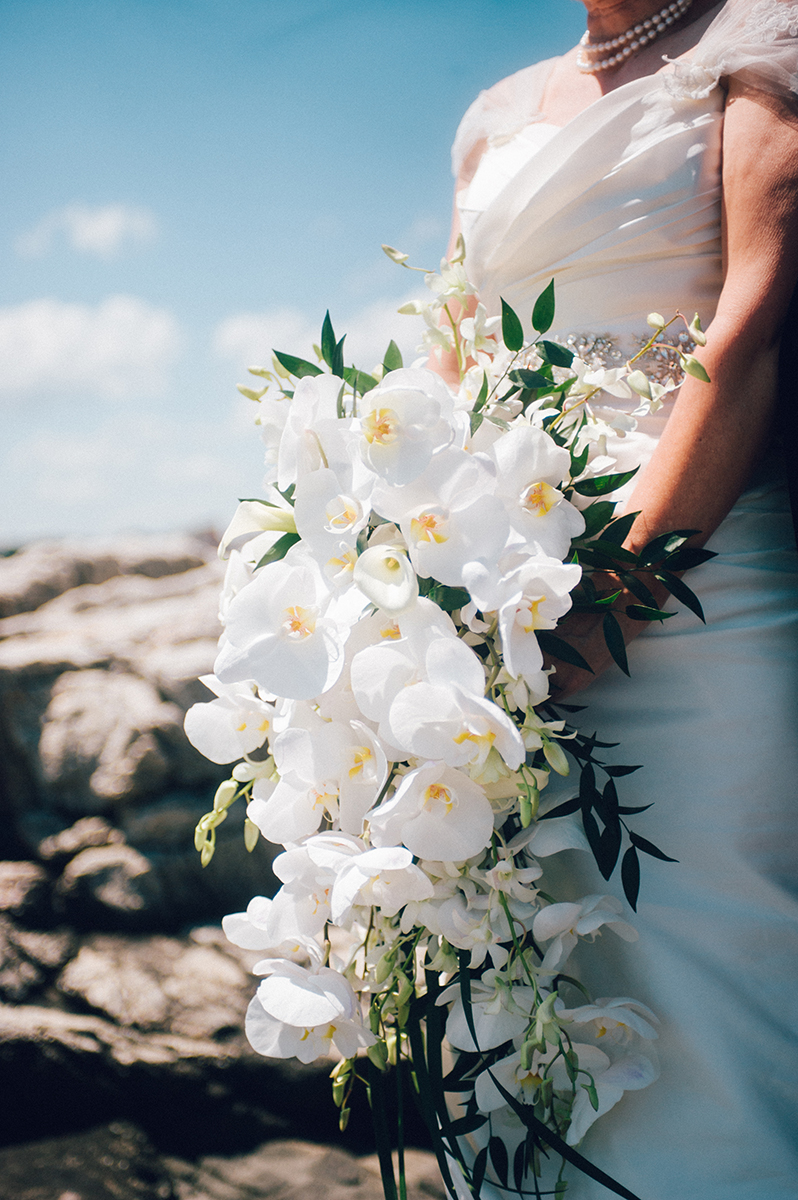Overflowing bridal bouquet of white orchids