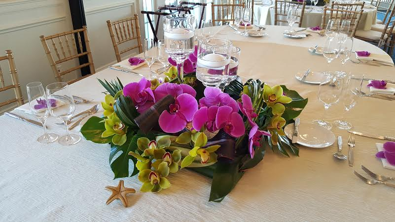 Purple orchid table centerpieces from Bouquets & Beyond