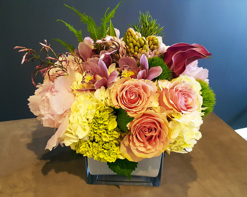 Floral arrangement for corporate and restaurants designed by Bouquets & Beyond