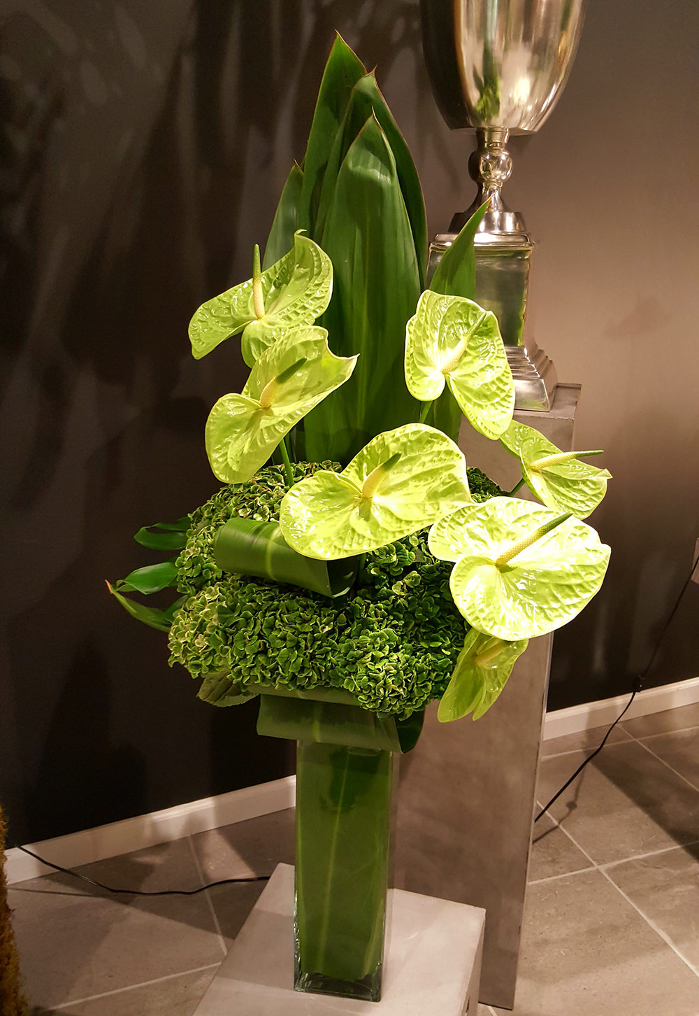 Green flowers, moss and leaves designed for corporate decor by Bouquets & Beyond in Woodbury, CT