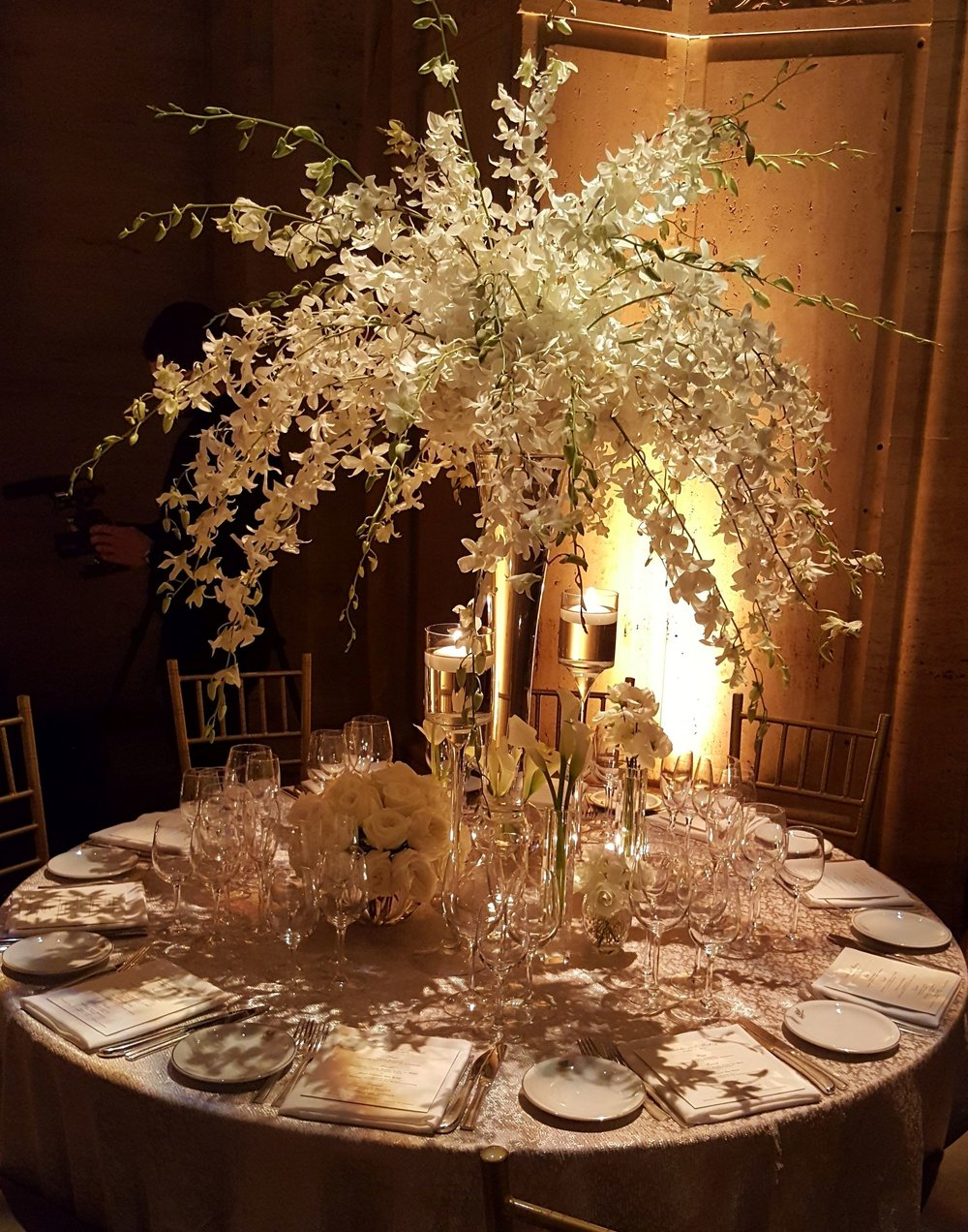 Vast and intricate white flower table arrangement designed by Bouquets & Beyond