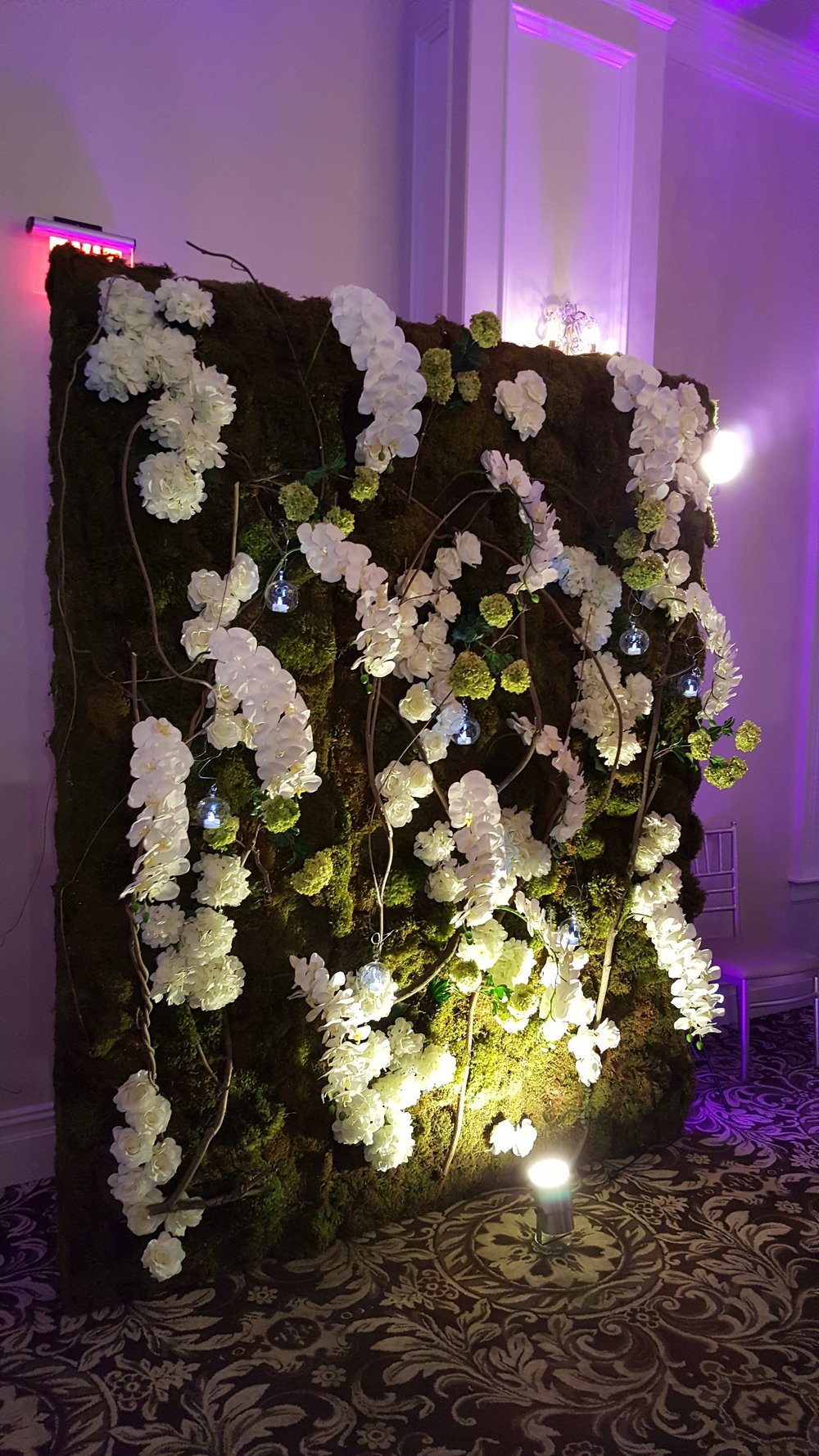 Decorative florals made for a wedding reception by Bouquets & Beyond