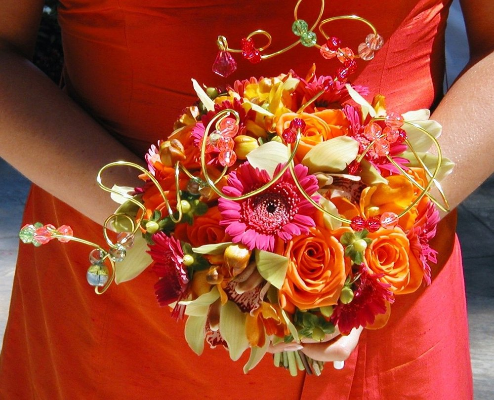 Bright and vibrant fuchsia and orange bouquet for a bridesmaid