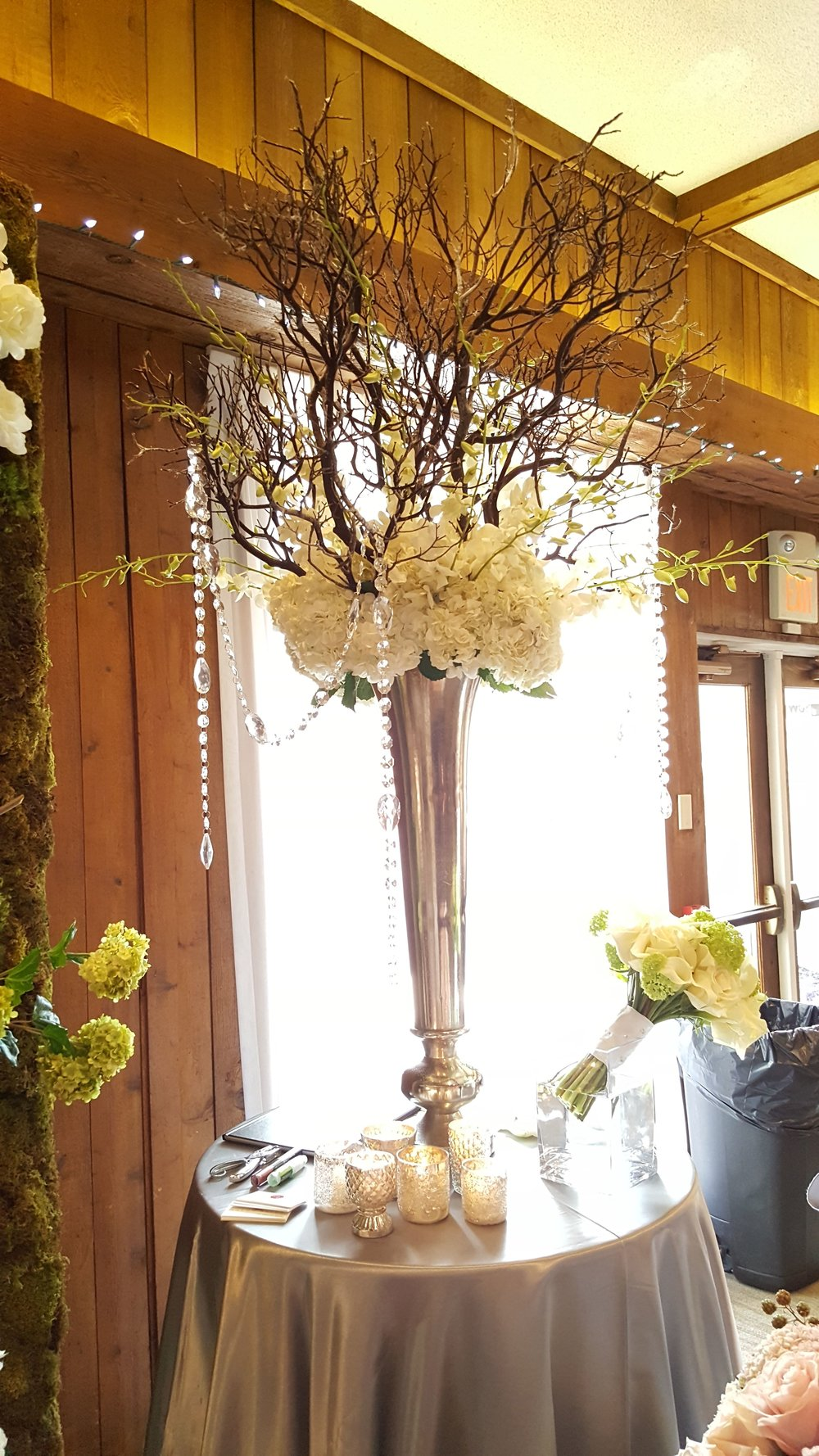 Tall and intricate flower table centerpiece for a wedding reception