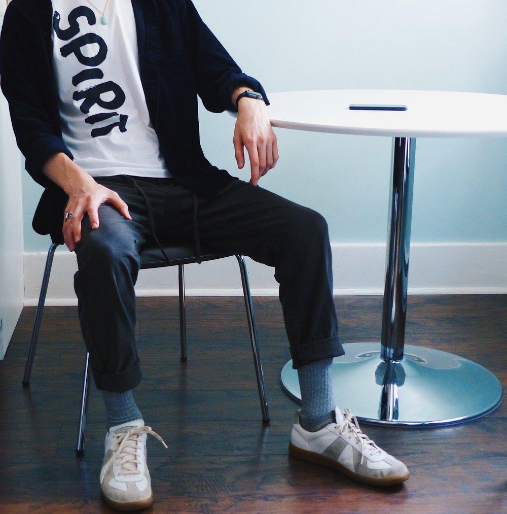 Wearing:   Comme des Garçons T-Shirt  Maison Martin Margiela Trainers