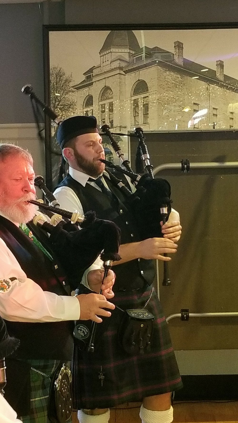 Pipe Major Fred Merrit and Novice Piper Killian Smith at the 5th street hall for the 2018 St. Patricks Day Pub Crawl.
